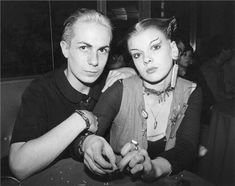 Simon Barker with Soo Catwoman at Louise's Club London 1976 by Bob Gruen