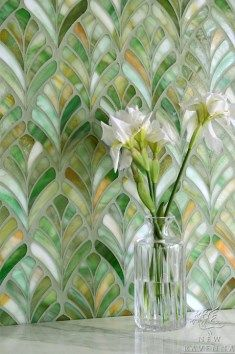 """Among the leading mosaic tile producers in North America, New Ravenna, based in Exmore, Virginia, creates intricate patterns with vibrant hues and lustrous finishes that are nothing short of extraordinary.  Pictured below,  left,  is """"Margot,""""  a jewel glass waterjet mosaic shown in Emerald."""