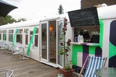 Deptford Cafe - Southeast London. Sells meals from locally sourced ingredients. Made from an old train carriage donated by South East Trains. Part of a CREATIVE COMMUNITY SPACE which also includes designers' studios, a communal garden and an outdoors silent cinema with fantastic blooming umbrellas made from old pink parachutes. We need more of these initiatives!