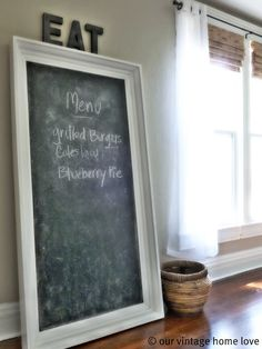 Huge chalkboard. Love the words EAT above it. Could square off and paint a chalk board on the wall then frame it using crown molding. much cheaper!