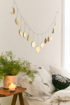 Check out Hammered Extra-Long Metal Moon Cycle Banner from Urban Outfitters