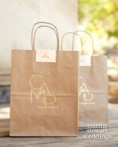 Upon arrival at El Capitan Canyon, guests received brown paper bag care packages that were gold foil-stamped with the day\'s logo and filled with provisions including snacks and bottled water.