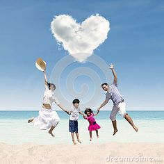 Happy Family Jumping Under Love Cloud At Beach - Download From Over 44 Million High Quality Stock Photos, Images, Vectors. Sign up for FREE today. Image: 38409335