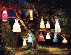 Tim Walker dresses as lamps on a tree