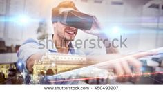 Cityscape by night against man using a virtual reality device
