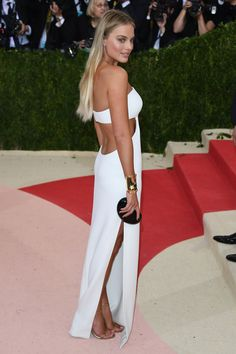 2016 Met Gala - Margot Robbie in Calvin Klein Collection with Jimmy Choo shoes and jewellery by Tiffany & Co   - HarpersBAZAAR.co.uk
