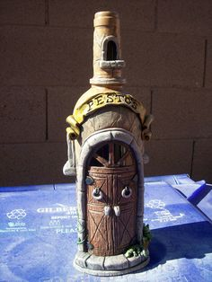 Polymer clay on empty wine bottles to sculpt these customized front doors.