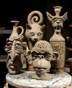 A man, a monkey, and a couple of cats by Mitchell Grafton. -via Grafton Pottery, FB