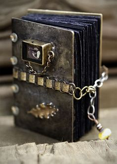 Snips and Snails and Puppy Dog Tails: Beautiful metalwork journal cover - I love the adjustable link fastening on this one.