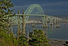 Yaquina Bay Bridge -- DSC2471... Where U.S.Highway 101 enters the City of Newport from the south in  Lincoln County on the central Oregon coast.   One of about 11 bridges  on the Oregon coast designed by Conde B. McCullough, construction  began in August 1934 and it was completed in 1936 and officially  opened on September 6th of 1936.  It is on NRHP as #05000821.