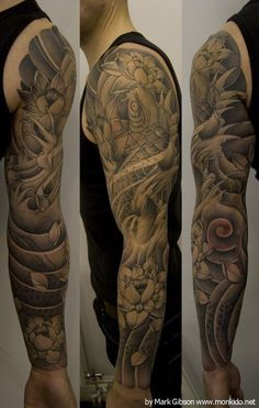 japanese black and grey tattoo sleeve with a nice lotus flower on the bottom half as well as the top half