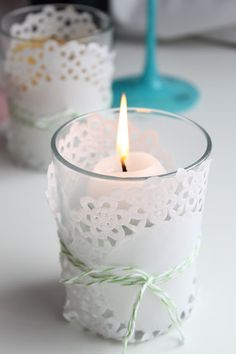 Wrap paper doilies around candles and tie with string. <3