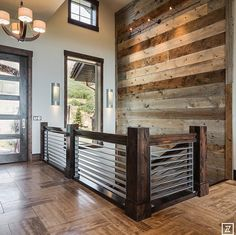 High Ceilings Staircase Reclaimed wood wall :)