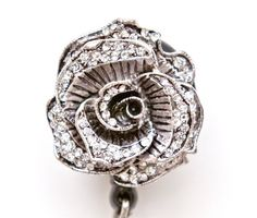 Rhinestone embellished Rose. Retractable Badge Reel for easy ID Swipe. Slide clip on back to clip on belt, shirt, scrubs, or lanyard. Great decorative piece to dress up your daily attire.