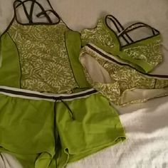 Bathing suit set Make 4 looks mixing up the 4 pieces. Great condition.  However the string is missing in the bikini bottom. Lands' End Swim