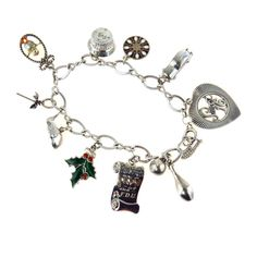 1960s Sterling Silver Charm Bracelet, Vintage, 1930s to 1980s   We are totally charmed by this vintage 1960's retro charm bracelet. It is made of Sterling Silver and holds 10 different charms. The charms are a big heart Sweet 16, a vintage car with turning wheels, a Dutch hex sign for protection, a cake with moving candles (so cute!), mistletoe (pucker up), Jonah in the whale (literally, the mouth opens), a palm tree, little chick in an oval (the egg?), a diploma engraved with the date 6-64…