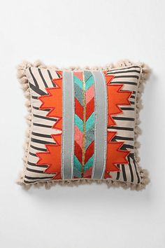 beaded, tasseled and embroidered linen cotton pillow. Beautiful tasseled and embroidered linen-cotton pillow combines earthy southwestern motifs with slick Palm Springs hues. Can be used on either side.