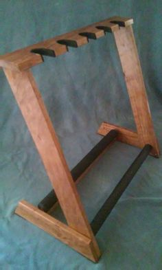 5 space guitar stand handcrafted with select AAA Cherry wood! Guitar Storage, Guitar Rack, Guitar Hanger, Diy Guitar Stand, Wooden Guitar Stand, Diy Wood Projects, Woodworking Projects, Home Recording Studio Setup, Sound Room