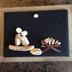 "Pebble Art by Denise. ""By the Fire"" . Photo taken before placed in shadow box frame."