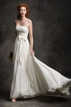 Flowing chiffon gown with bow accent by Ella Rosa Gallery, $492.Check out more gorgeous dresses in our Ella Rosa Gallery wedding gown gallery ►