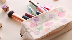 Why didn't we think of this idea before? Transform a simple canvas zipper bag into a Disney-themed pencil or makeup bag.