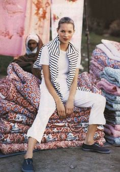 Kate Moss sitting pretty on a pile of antique carpets! #Carinilang #femme
