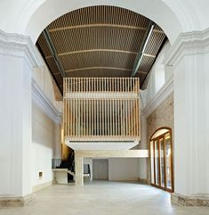 Madrid studio Adam Bresnick Architects has revived the sixteenth-century interior of a chapel in Spain by reinstating a vaulted ceiling and building a timber-clad box that hovers above the floor Church Architecture, Space Architecture, Beautiful Architecture, Architecture Details, My Home Design, House Design, Architecture Religieuse, Madrid, Religious Architecture