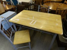 Kitchen / dining table with two chairs, top marked. Measurements are H-78cm W-120cm D-76cm -------------- £20 (pc110)