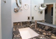 """x Isn't this one of the """"coolest"""" counter tops you have ever seen? Gorgeous modern chrome fixtures highlight this vanity in this South Austin, TX bathroom remodel."""