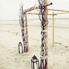 Beach wedding chuppah made of branches and wood the couple brought with them to the venue. Heba Salama Photography.