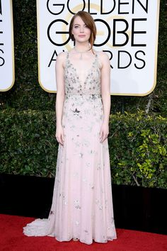 """""""Well, it's got stars on it,"""" Emma Stone told E! host Ryan Seacrest when asked about her Valentino gown. And, well yeah, it does — but it's also the perfect dress to follow-up Stone's incredible role in La La Land. If this doesn't say movie star (literally), we don't know what does. #refinery29 http://www.refinery29.com/2017/01/135216/golden-globes-2017-red-carpet-fashion#slide-31"""