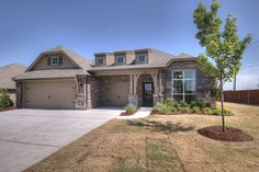 Simmons homes exposed home in lake valley owasso for Simmons homes floor plans