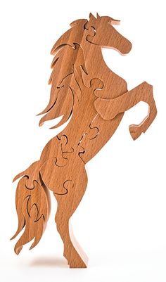 This energetic mustang puzzle design by Eric Van Malderen embodies the essence of nature. Learn more about the projects in Scroll Saw Woodworking & Crafts Holiday 2015 (Issue 61) at http://scrollsawer.com/2015/11/05/scroll-saw-woodworking-crafts-holiday-2015-issue-61/.