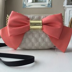 "HP Betsey Bow Bow Bow Bag Cream color quilted bag with large coral bow! Gold chain & black 47.5"" attached strap. Bag measures 9"" across & 6.5"" up&down including depth.NWT  HP chosen by @kendall627 4/3 Thank you Beautiful Kendall! Betsey Johnson Bags Mini Bags"