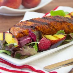 An awesome flavor combination of grilled chili and brown sugar-rubbed salmon served on lettuce with grilled peaches, raspberries and orange vinaigrette.