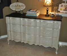 Beautiful custom painted solid wood French dresser. It has been painted in a vintage off white/gray with subtle pearl metallic around the drawers and on the pulls. Deep java stain on top.