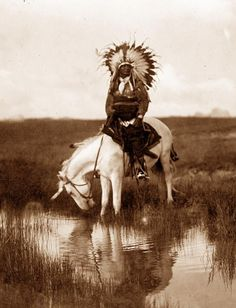 "An Oasis in the Badlands - ""This image was made in the heart of the Bad Lands of South Dakota. The subject is Red Hawk (Cheta'-luta) , sub-chief of the Ogalala Sioux. Born 1854."" -Curtis Photograph 1905"