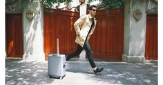 COWAROBOT the carry-on suitcase that autonomously rolls along with you Richard Branson, Carry On Suitcase, Carry On Luggage, United Airlines, British Airways, Portable Usb Charger, Dog Safety, Smart Car, Follow You