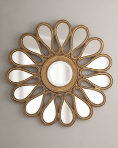 "38"" sunburst mirror is made of resin and metal, with a gilded finish."