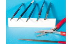 making buildings in foamboard: To emboss bricks or cobblestones into the foam, I've made tools from old paintbrushes with no more bristles left, and shaped the ferrules into the form desired with fine pointed pliers.