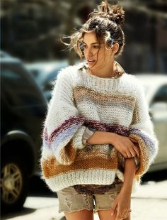 Fashion style: Messy high bun + oversize sweater + distressed sand tone mini denim pants.