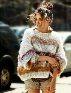 Fashion style: Messy high bun + oversize sweater + distressed sand tone mini denim pants.