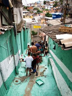 Children Paint Positive Words Across Brazil's Shanty Town - featured on designtaxi.com