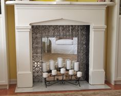 Love the look of this faux silver ceiling tin with a mirror in the fireplace (not a real one)
