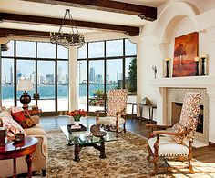 LIVING ROOM WITH VIEW:  The thoroughly modern panorama outside nicely juxtaposes with this old-world living room because the walls are in style but simple.  bhg.com