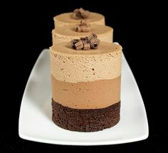 Impress guests with individual Triple Chocolate Mousse Cakes, perfect for entertaining. Find recipe for Triple Chocolate Mousse Cakes at Grace& Sweet Life. Food Cakes, Cupcake Cakes, Cupcakes, Mini Cakes, Mini Desserts, Delicious Desserts, Dessert Recipes, Yummy Food, Eggless Desserts