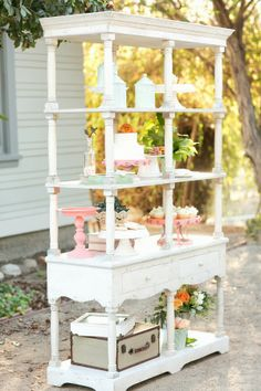 Cualquier aparador o librería antigua puede servir para colocar la torta o la mesa dulce, en lugar de la tradicional mesa vestida Peach & tiffany blue shabby chic wedding  |  The Frosted Petticoat