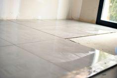 Unfinishe resilient tile flooring.