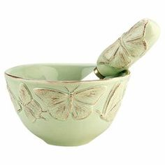 "Add a pop of style to your tablescape with this lovely butterfly-themed bowl and spreader set, perfect for serving clotted cream or your signature tapenade.  Product: Bowl and spreaderConstruction Material: Ceramic and metalColor: Light greenFeatures:  Butterfly motifLead-free10 Ounce capacity Dimensions: 3"" H x 4"" DiameterCleaning and Care: Microwave and dishwasher safe"