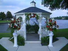 Wedding Flowers. Altar Arrangements. Maybe just the top decor and skip the two side arrangements? Gazebo Decor. Red and white. http:thebloomingidea.blogspot.com